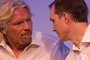 Sir Richard Branson consults with Virgin Galactic CEO George Whitesides during a new space tourism presentation. Whitesides is responsible for guiding all aspects of the company to commercial operation at Spaceport America in New Mexico. Prior to this he was Chief of Staff for NASA, where he provided policy and staff support to the agency's Administrator. Virgin Galactic is a company within Richard Branson's Virgin Group which plans to provide sub-orbital spaceflights to space tourists, suborbital launches for space science missions and orbital launches of small satellites. Further in the future Virgin Galactic hopes to offer orbital human spaceflights as well. Virgin Galactic's spacecraft are launched from a large aeroplane, giving the spacecraft more initial speed and altitude than if it were launched from the ground.