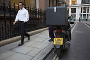 Motorcycle courier who appears to only have one leg. London, UK.