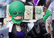Pine Bush, New York - A woman dressed as an aliens waves to the crowd on Main Street during the parade at the Pine Bush UFO Fair on  on April 26, 2014.