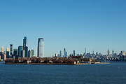 Liberty Island, NY - 9 January 2020. Hoboken, NJ, with Ellis Island in the foreground, and Manhattan in the distant right, seen from Liberty Island.