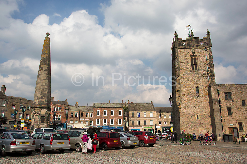 Richmond is a market town and the centre of the district of Richmondshire. Historically in the North Riding of Yorkshire, it is situated on the edge of the Yorkshire Dales National Park. North Yorkshire, England, UK. Trinity Church Square and the cross in the market square.