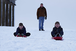 © Licensed to London News Pictures. 08/01/2021. Darlington, UK. Williams Downs,9, and Aaron Downs,9, enjoy sledging in the snow at Hardwick County Park in Darlington.The Met Office issues yellow weather warning of snow and ice that will be affecting many parts of the UK for today.Photo credit: Ioannis Alexopoulos/LNP