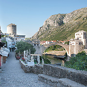 MOSTAR, BOSNIA AND HERZEGOVINA - JUNE 26:  A general view of the walk along the street leading to the Old Bridge on  June 26, 2013 in Mostar, Bosnia and Herzegovina.The Siege of Mostar reached its peak and more cruent time during 1993. Initially, it involved the Croatian Defence Council (HVO) and the 4th Corps of the ARBiH fighting against the Yugoslav People's Army (JNA) later Croats and Muslim Bosnian began to fight amongst each other, it ended with Bosnia and Herzegovina declaring independence from Yugoslavia.  (Photo by Marco Secchi/Getty Images)