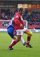 Photo: Dave Linney.<br />Walsall v Hartlepool United. Coca Cola League 1. 17/12/2005.Paul Merson(Walsall) keeps the Hartlepool defence at bay.