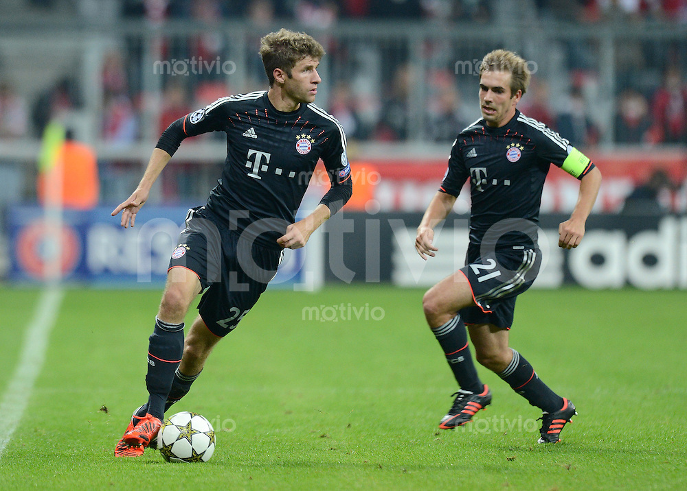 FUSSBALL   CHAMPIONS LEAGUE   SAISON 2012/2013   GRUPPENPHASE   FC Bayern Muenchen - FC Valencia                            19.09.2012 Thomas Mueller und Philipp Lahm (v. li., FC Bayern Muenchen)