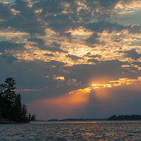 The sun sets over islands in Lake of the Woods, Ontario, Canada.