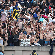 NEW HAVEN, CONNECTICUT - NOVEMBER 18: Yale fans remove their shirts during a third period ritual during the Yale V Harvard, Ivy League Football match at the Yale Bowl. Yale won the game 24-3 to win their first outright league title since 1980. The game was the 134th meeting between Harvard and Yale, a historic rivalry that dates back to 1875. New Haven, Connecticut. 18th November 2017. (Photo by Tim Clayton/Corbis via Getty Images)