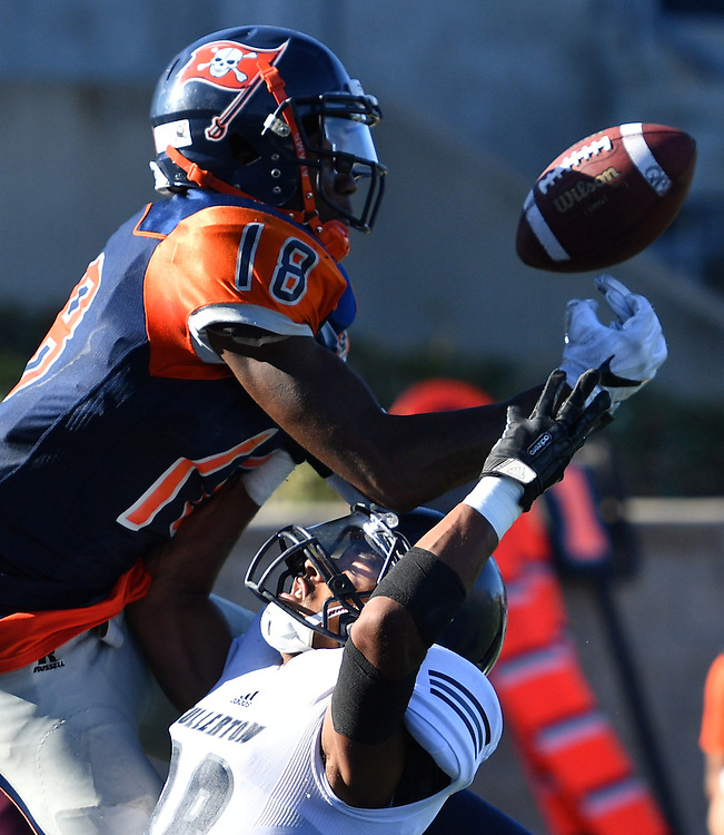 Orange Coast Pirate wide receiver James Rutledge (18) attempts to haul in a pass during Orange Coast College vs Fullerton College  football action Saturday in Coast Mesa.<br /> <br /> @2016 Rick May Photography / Sports Shooter Academy - Rick May Photography