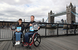 Overall winners of the wheelchair men and women's Abbott World Marathon Majors Series Switzerland's Marcel Hug (right) and Manuela Schar during a photocall outside Tower Bridge, London. PRESS ASSOCIATION Photo. Picture date: Monday April 23, 2018. See PA story ATHLETICS London. Photo credit should read: John Walton/PA Wire