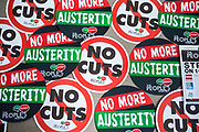 No Cuts & No more austerity signs from the Peoples Assembly  at their Stand Up Against Austerity. Live at the Hammersmith Apollo. London.