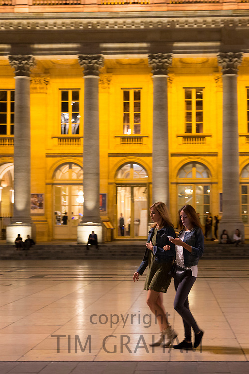Young women texting with smartphone by the Grand Theatre in Place de la Comedie, Bordeaux, France