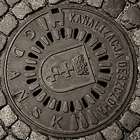 Manhole cover. Old Town Gdańsk walkabout during St Dominic's festival with a Fuji X-T1 camera.