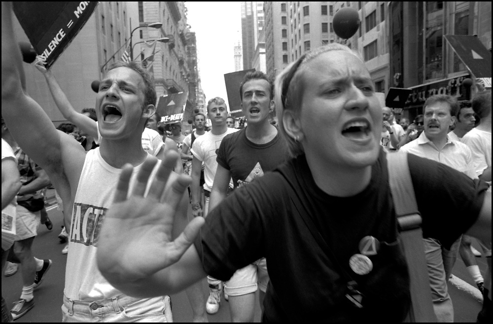 """Danny Fass, Joe Ferrari and Amanda Rhinehart of ACT UP NY, on June 24, 1989, the 20th anniversary of the Stonewall riots, participating in a renegade march up 6th avenue to Central Park. Themed, """"In The Tradition"""", this march followed the same route as the original march 20 years ago and was designed as a rebuke to the corporatization of the gay pride parade."""