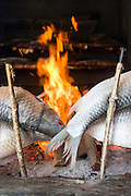Masgouf river fish cooking on the open fire, Bait Al Baghdadi restaurant, United Arab Emirates