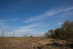 Calvert, UK. 26th April, 2021. An area almost entirely cleared of trees and vegetation for the HS2 high-speed rail link is viewed from the remainder of Calvert Jubilee Nature Reserve. Calvert has been particularly badly impacted by HS2 infrastructure project work because of its position close to the intersection between HS2 and East West Rail and a large section of Calvert Jubilee Nature Reserve has been destroyed.