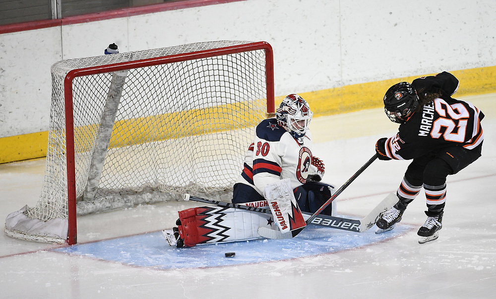 ERIE, PA - MARCH 04: Molly Singewald #30 of the Robert Morris Colonials makes a save on a shot by Jordan Marchese #22 of the RIT Tigers in the second period during the game at the Erie Insurance Arena on March 4, 2021 in Erie, Pennsylvania. (Photo by Justin Berl/Robert Morris Athletics)