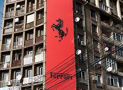 Contrast of Ferrari store in old communist era apartment block in central Bucharest Romania