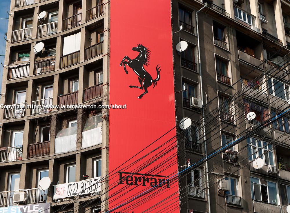 Contrast of Ferrari store in old communist era apartment block in central Bucharest Romania