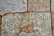 Hittite Hieroglyphic panel from a cult chamber 2 built by Suppiiuliuma II in Hattusa, Hittite New Kingdom 1207–1178 BC, Bogazkale archaeological Museum, Turkey.<br /> <br /> The Luwian hieroglyphics is a kind of hieratic script which was developed in Anatolia and has no relationship to Egyptian hieroglyphics. In these panels King Suppiluliuma II mentions that by the support of many gods he has conquered many countries including the Land of Tarhuntassa, where he has built new cities and has offered sacrifices to the gods. The chamber may have been a symbolic entrance to the underworld which plays an important part in Hittite cult and beliefs