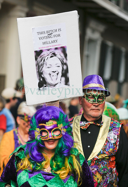 31 January 2016. New Orleans, Louisiana.<br /> Bill and Hillary Clinton inspired placards in the crowd at the Mardi Gras Dog Parade. The Mystic Krewe of Barkus winds its way around the French Quarter with dogs and their owners dressed up for this year's theme, 'From the Doghouse to the Whitehouse.' <br /> Photo©; Charlie Varley/varleypix.com