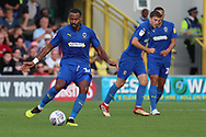 AFC Wimbledon midfielder Liam Trotter (14) passing the ball during the EFL Sky Bet League 1 match between AFC Wimbledon and Scunthorpe United at the Cherry Red Records Stadium, Kingston, England on 15 September 2018.