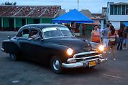 Old American car at dusk in Gibara, Holguin, Cuba.