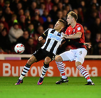 Newcastle United's Dwight Gayle shields the ball from Barnsley's Marc Roberts<br /> <br /> Photographer Chris Vaughan/CameraSport<br /> <br /> The EFL Sky Bet Championship - Barnsley v Newcastle United - Tuesday 18th October 2016 - Oakwell Stadium - Barnsley<br /> <br /> World Copyright © 2016 CameraSport. All rights reserved. 43 Linden Ave. Countesthorpe. Leicester. England. LE8 5PG - Tel: +44 (0) 116 277 4147 - admin@camerasport.com - www.camerasport.com