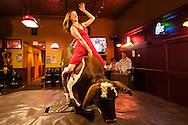 Woman, mechanical bucking bull, riding, Livingston, Montana
