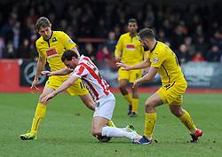 Cheltenham Town's Matt Sparrow is fouled by Plymouth Argyle's Peter Hartley - Photo mandatory by-line: Nizaam Jones - Mobile: 07966 386802 - 28/03/2015 - SPORT - Football - Cheltenham - Whaddon Road - Cheltenham Town v Plymouth Argyle - Sky Bet League Two