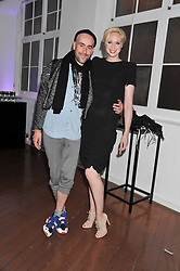 RICHARD SLOANE and GWENDOLINE CHRISTIE at a party for Giles Deacon hosted by Mercedes Benz held at Elms Lesters Painting Rooms, Flitcroft Street, London WC2 on 19th September 2011.