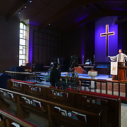Kyle Folger, left, records Rev. Stephen Swisher's sermon at Epworth United Methodist Church in Toledo on Tuesday, April 21, 2020. THE BLADE/KURT STEISS