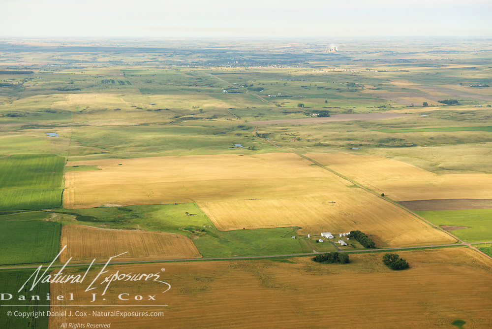 Agricultural lands with a cole fired power plant in the background, North Dakota.   Agricultural lands, North Dakota.