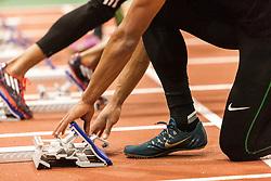 The 108th Millrose Games Track & Field: Ashton Eaton adjusts sprinter's block