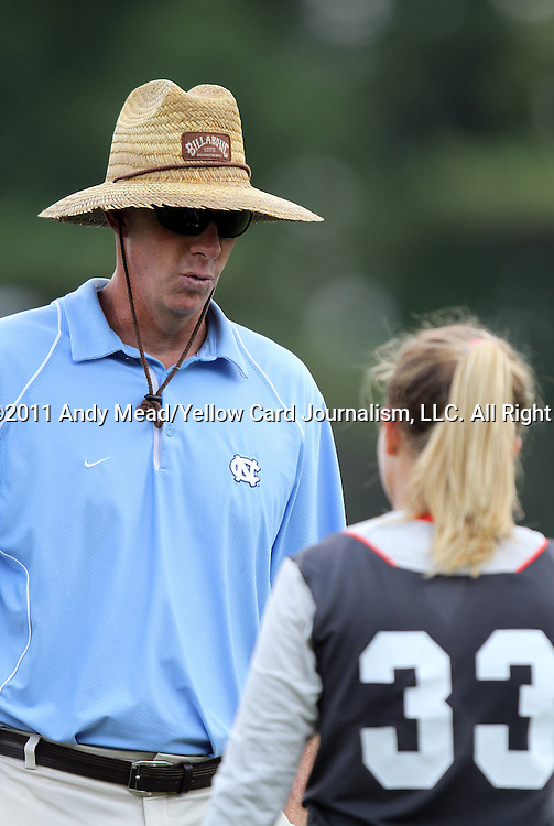 11 September 2011: UNC goalkeeper coach Chris Ducar with Adelaide Gay (33). The Texas A&M Aggies defeated the University of North Carolina Tar Heels 4-3 in overtime at Koskinen Stadium in Durham, North Carolina in an NCAA Division I Women's Soccer game.
