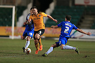 Darren Jones of Newport county © is challenged by Carl Magnay of Hartlepool. Skybet football league two match, Newport county v Hartlepool Utd at Rodney Parade in Newport, South Wales on Tuesday 15th March 2016.<br /> pic by Andrew Orchard, Andrew Orchard sports photography.