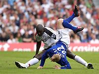 Photo: Daniel Hambury.<br /> Fulham v Everton. The Barclays Premiership.<br /> 27/08/2005.<br /> Fulham's Luis Boa Morte sends Everton's Tony Hibbert into the air.