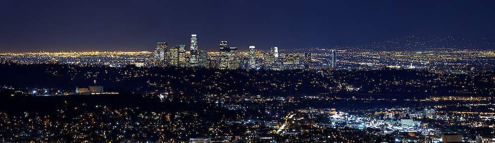 A panoramic format view of the Los Angeles skyline at night