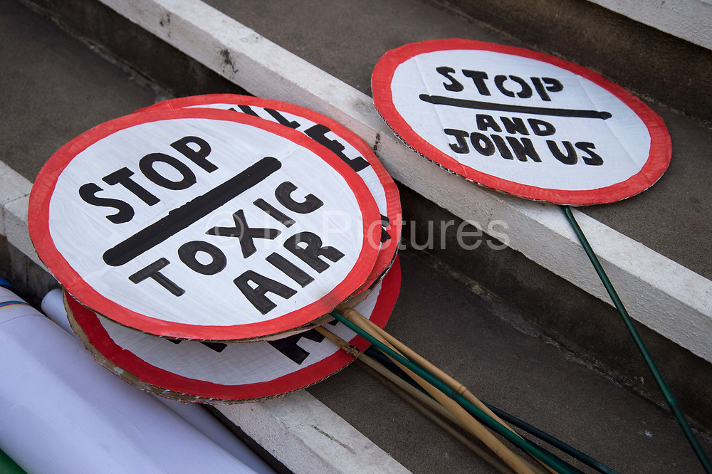 The Air that we Grieve march on July 12th 2019 in East London, United Kingdom. Organised by Extinction Rebellion to draw attention to air pollution and the climate emergency. Round placards saying Stop Toxic air and Stop and join us.