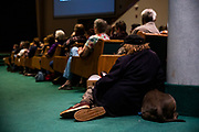 PARADISE, CA - NOVEMBER 08: An audience member looks on while hugging his dog during the Paradise Commemoration Ceremony at the Paradise Alliance Church, on November 8, 2019 in Paradise, California. It has been one year since the Camp Fire, caused by PG&E transmission lines, tore through the town of Paradise, California, killing 85 people and destroying more than 18,000 homes and businesses, becoming the deadliest and most destructive fire in the history of California. (Photo by Philip Pacheco/Getty Images)