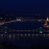 Chain bridge is seen with green light decoration celebrating Saint Patrick's Day in central Budapest, Hungary on March 17, 2017. ATTILA VOLGYI