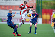Mickel Miller of Hamilton Academical FC out jumps Steven Naismith of Heart of Midlothian during the Ladbrokes Scottish Premiership League match between Hamilton Academical FC and Heart of Midlothian FC at New Douglas Park, Hamilton, Scotland on 4 August 2018. Picture by Malcolm Mackenzie.