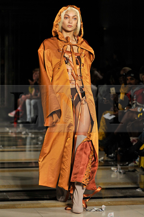 © Licensed to London News Pictures. 16/02/2018. LONDON, UK. A model presents a look by Fortie Label at Fashion Scout AW18, part of London Fashion Week, taking place at Freemasons Hall in Covent Garden.  Photo credit: Stephen Chung/LNP