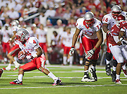 Sep 10, 2011; Little Rock, AR, USA; New Mexico Lobos running back Demarcus Rogers (4) carries the ball as offensive linemen Jamal Price and Korian Chambers (68) defend during the second half of a game against the Arkansas Razorbacks at War Memorial Stadium. The Razorbacks beat the Lobos 52-3. Mandatory Credit: Beth Hall-US PRESSWIRE