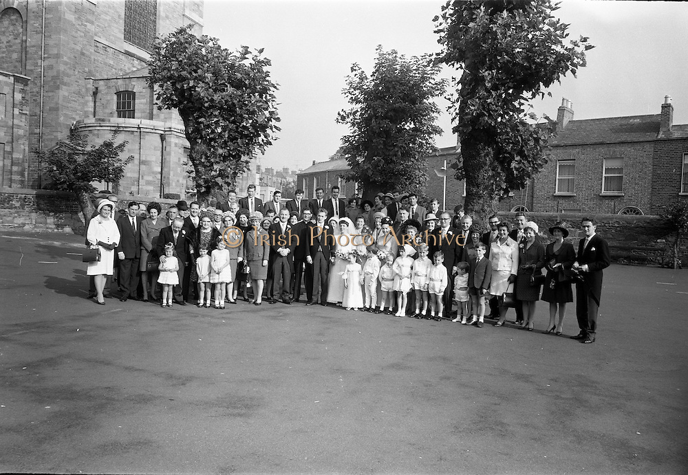 "16/09/1967<br /> 09/16/1967<br /> 16 September 1967<br /> Wedding of Mr Francis W. Moloney, 28 The Stiles Road, Clontarf and Ms Antoinette O'Carroll, ""Melrose"", Leinster Road, Rathmines at Our Lady of Refuge Church, Rathmines, with reception in Colamore Hotel, Coliemore Road, Dalkey. Image shows the whole attendance at the wedding outside the church after the ceremony."