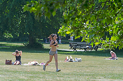 ©Licensed to London News Pictures 21/05/2020<br /> Greenwich, UK. A lady running. People out and about in Greenwich park, Greenwich, London this afternoon enjoying lockdown freedom as the mini heatwave hot weather continues with temperatures set to hit 28C in parts of the UK.  Photo credit: Grant Falvey/LNP