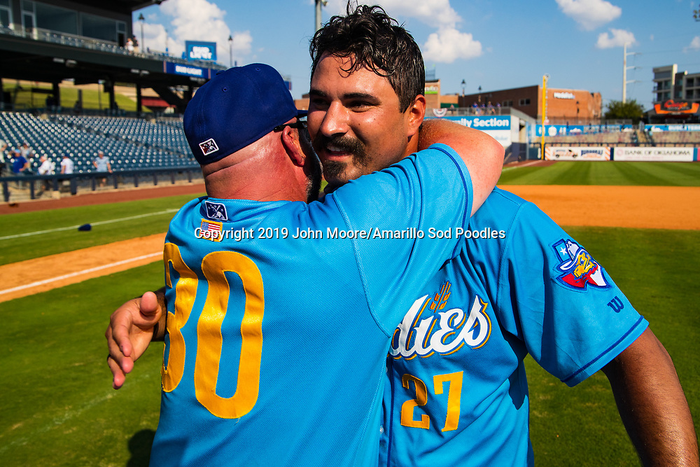 Amarillo Sod Poodles Manager Phillip Wellman and Amarillo Sod Poodles pitcher Travis Radke (27) celebrates after the Sod Poodles won against the Tulsa Drillers during the Texas League Championship on Sunday, Sept. 15, 2019, at OneOK Field in Tulsa, Oklahoma. [Photo by John Moore/Amarillo Sod Poodles]