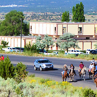 The Navajo Nation Council five-day summer session opened with hundreds of people riding horses, bicycles or running to the Council Chambers in Window Rock, Arizona. The horseback riders included delegates and supporters at the head of the caravan.
