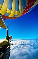 Hot air balloon pilot Lars-Eric More of Kapadokya Balloons looks out above the clouds over Cappadocia, Turkey