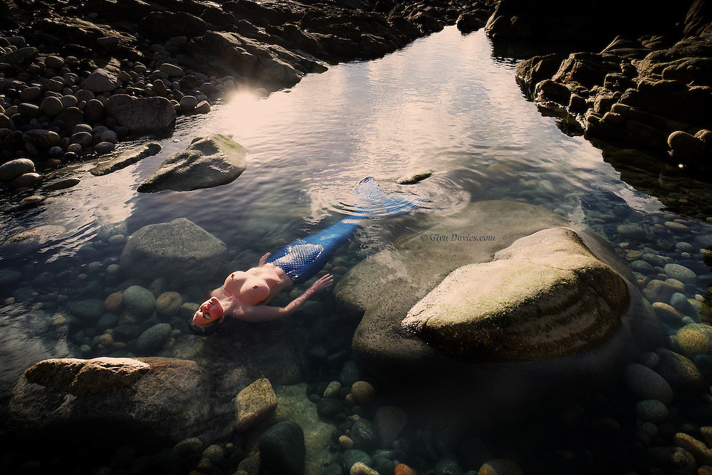 """""""She was in that state between deep sleep and first opening of the eyes. She was resting in a remote cove and the early morning sunlight spilled over the headland and across her figure. Even for a mermaid the warm sunshine is always welcome and she could feel its life giving energy as she stirred"""""""