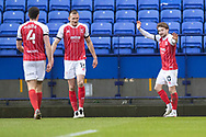 GOAL 0-1 Cheltenham Town forward Alfie May (10) celebrates his goal and asks team-mates to maintain the distance during the EFL Sky Bet League 2 match between Bolton Wanderers and Cheltenham Town at the University of  Bolton Stadium, Bolton, England on 16 January 2021.